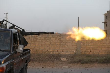 FILE PHOTO - Members of the Libyan internationally recognised government forces fire during fighting with Eastern forces in Ain Zara, Tripoli, Libya April 20, 2019. REUTERS/Hani Amara