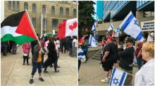 Duelling rallies at city hall stay peaceful