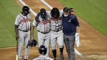Ronald Acuña Jr. needs help walking off field after fouling ball off his foot