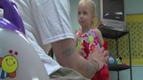 Teen dads behind bars receive parenting skills with The Baby Elmo Program
