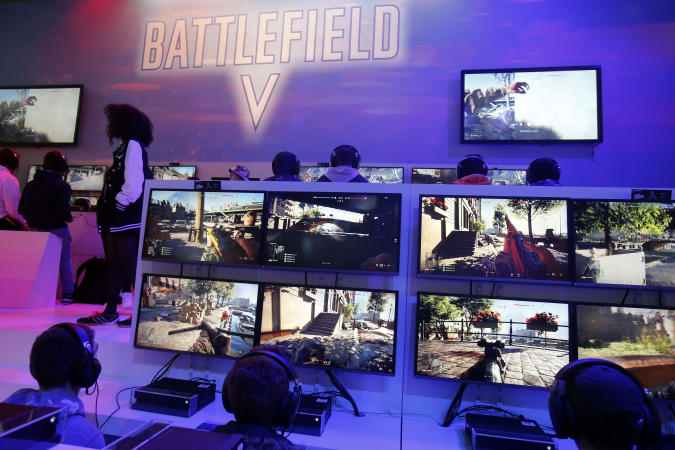 """PARIS, FRANCE - OCTOBER 27:  Gamers play the video game """"Battlefield V"""" developed by DICE and published by Electronic Arts (EA) during the 'Paris Games Week' on October 27, 2018 in Paris, France. 'Paris Games Week' is an international trade fair for video games and runs from October 26 to 31, 2018.  (Photo by Chesnot/Getty Images)"""