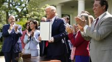 Trump signs executive order as he courts Hispanic voters