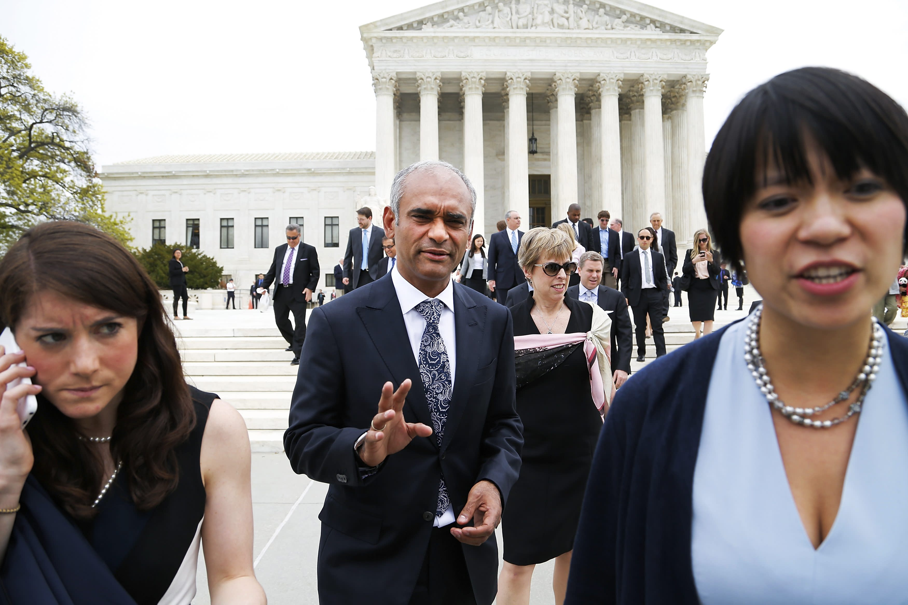 Aereo CEO and founder Chet Kanojia (C) departs the U.S. Supreme Court in Washington April 22, 2014. The court heard an appeal filed by the four major broadcasters, who say the online TV startup Aereo Inc steals copyrighted content, and the case is being closely watched due to concerns that a ruling against Aereo could call into question cloud computing services, in which personal files, including TV shows, are stored remotely on the internet. REUTERS/Jonathan Ernst (UNITED STATES - Tags: CRIME LAW BUSINESS MEDIA)