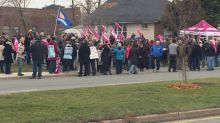 Dozens rally in support of Hearing Society workers in Windsor