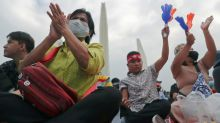 Thai protesters urge king to reach out as royalists also gather