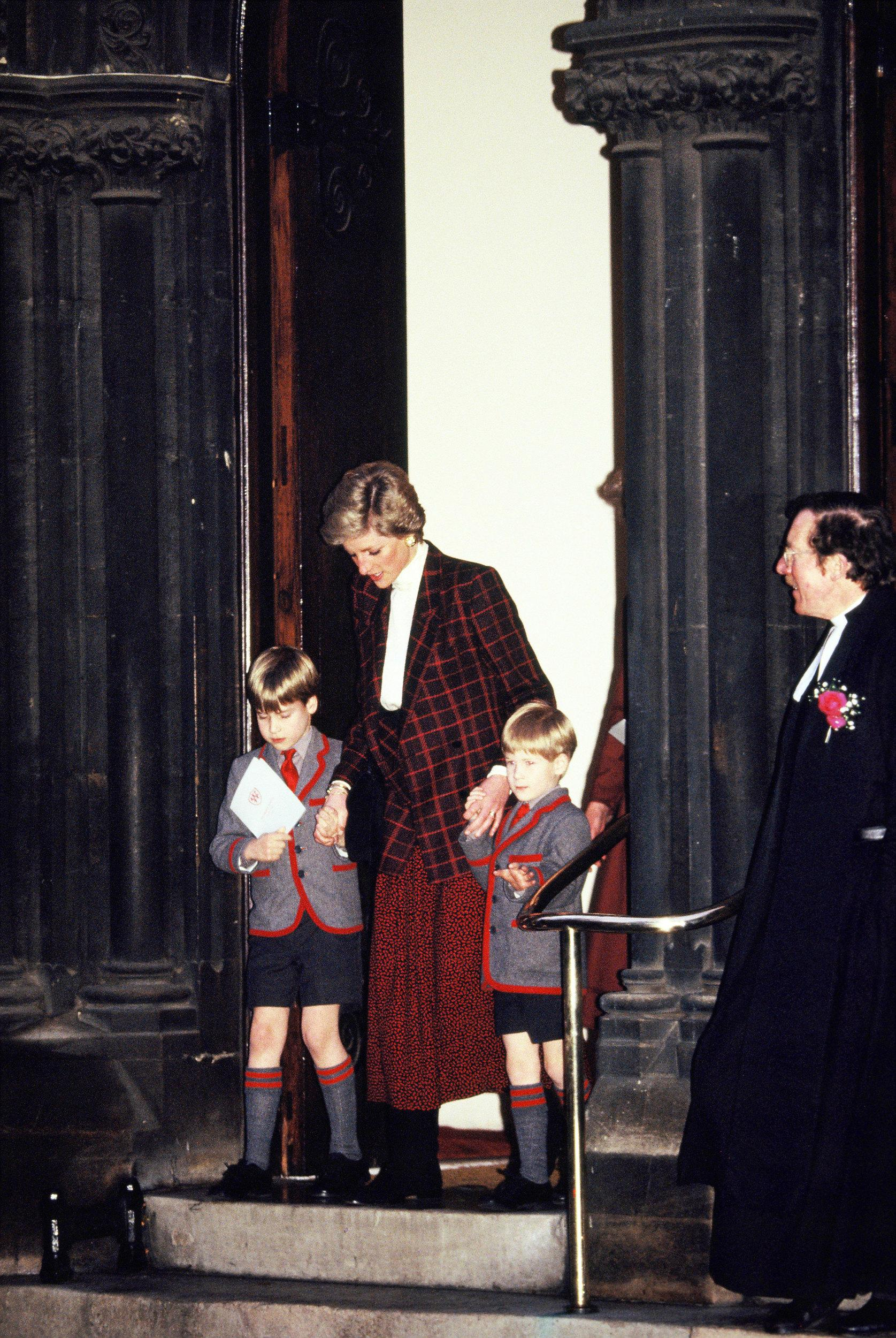 LONDON, UNITED KINGDOM - DECEMBER 13:  Diana (C), Princess of Wales, takes her sons Prince William (L) and Prince Harry (R) to the Christmas Carol Concert at Wetherby School on December 13, 1989 in London, England.  (Photo by Georges De Keerle/Getty Images)