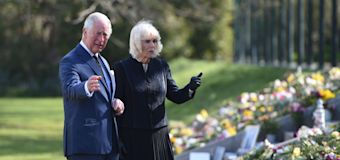 Tearful Charles views flowers left for Philip