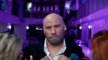 John Travolta is the surprise secret star of Pitbull's new music video