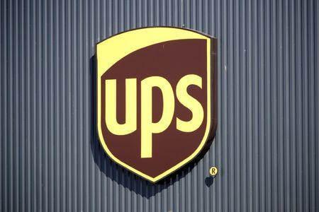 The Logo Of United Parcel Service Is Seen At New Package Sorting And Delivery Ups