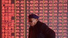 Mercados da China recuam por alertas de risco ao crescimento