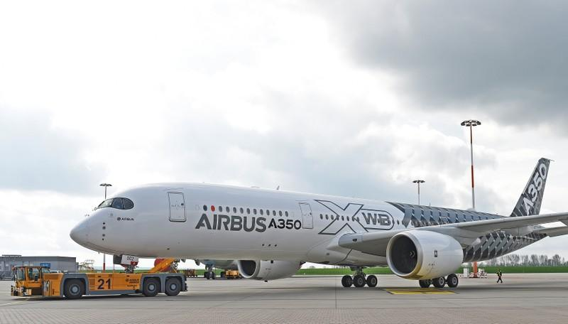 FILE PHOTO: An Airbus A350 XWB flight-test aircraft is towed during a media-day at the German headquarters of aircraft company Airbus in Hamburg-Finkenwerder