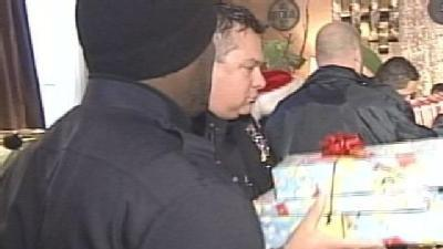 Police Deliver Christmas Cheer To Families in Need