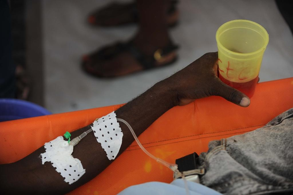 A cholera patient is treated at an emergency care center in the Martissan area of Port-au-Prince, Haiti, on December 9, 2014