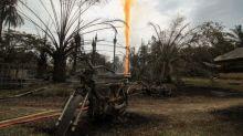 Blaze at illegal oil well in Indonesia kills 18, dozens hurt