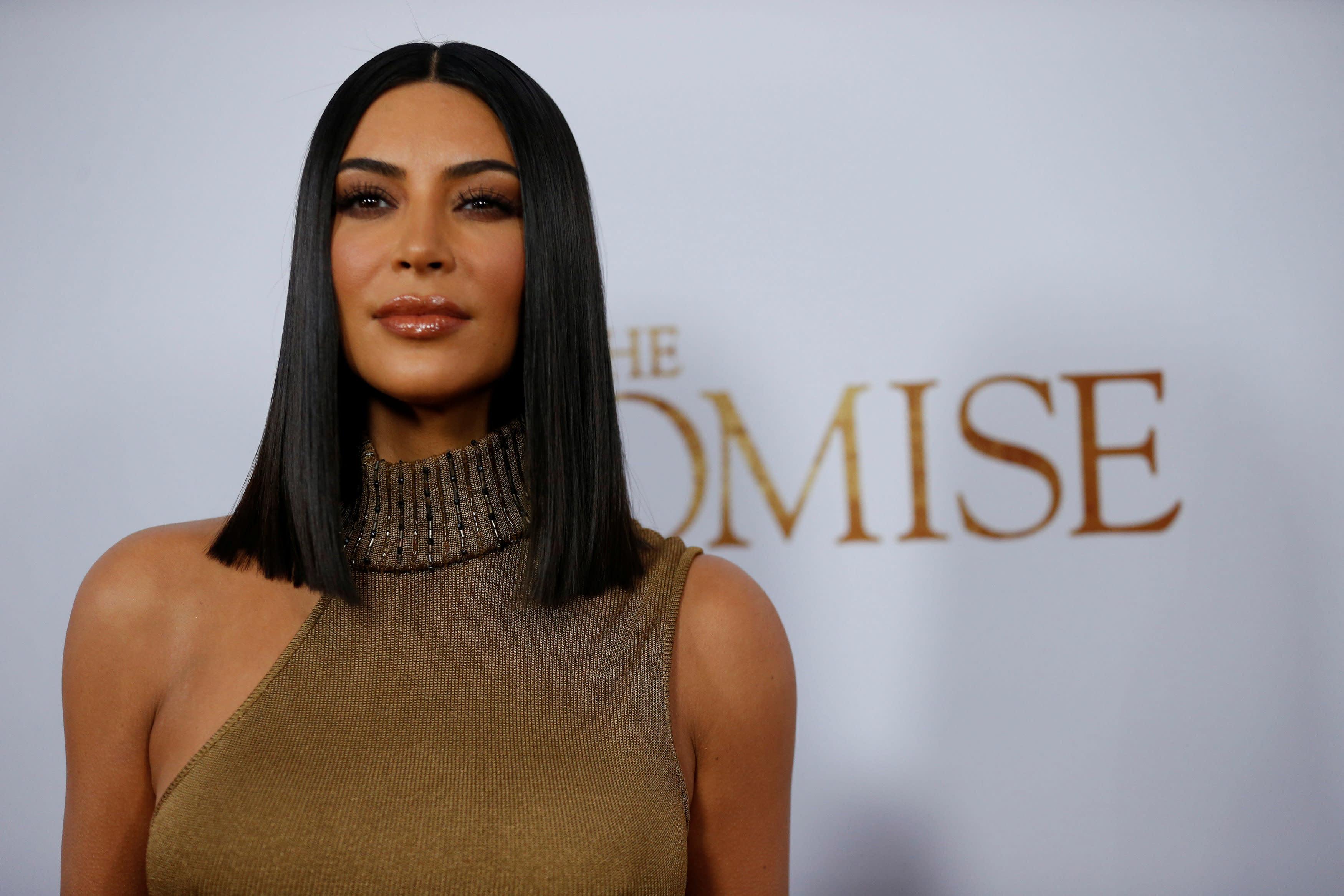 Kim Kardashian Faces Criticism For Car Seat Photo