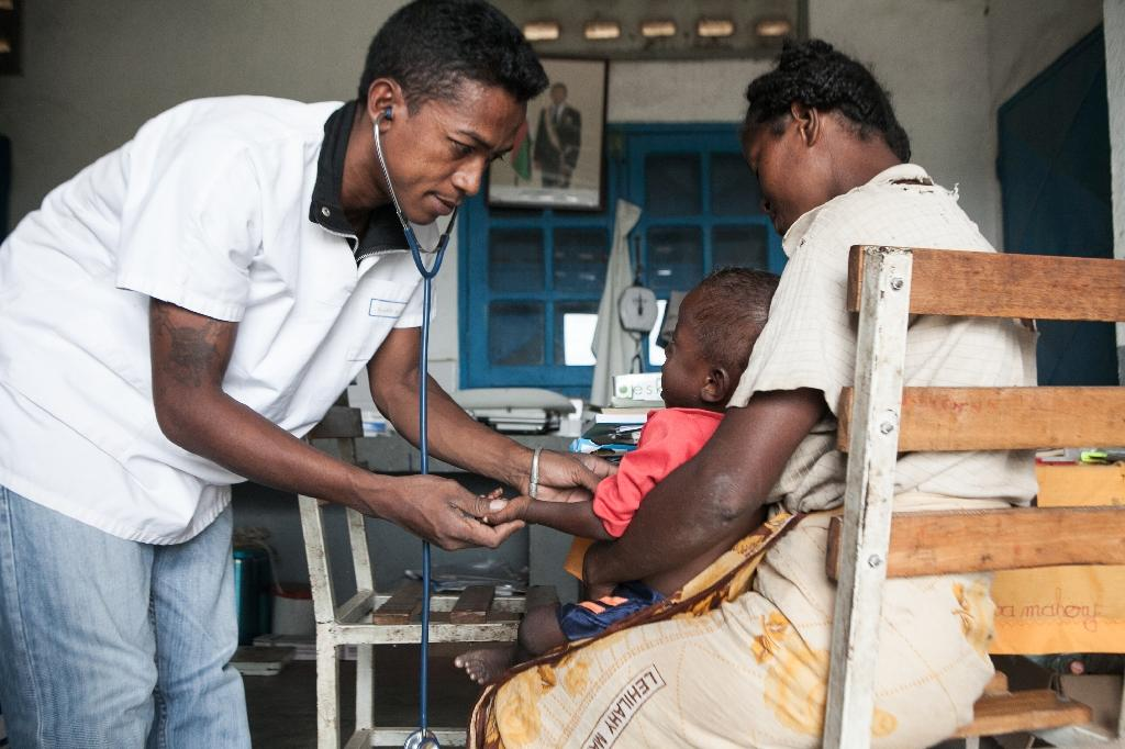 A doctor examines a child in the village of Imongy, in the Tsihombe district of southern Madagascar on March 4, 2015