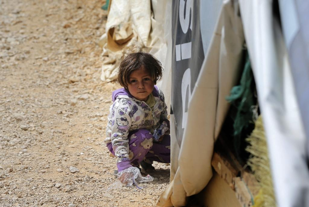 A Syrian child plays at a refugee camp in Lebanon's town of Bar Elias in the Bekaa Valley, on May 13, 2016 (AFP Photo/Joseph Eid)