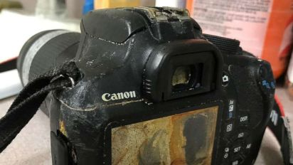 Camera found ashore with newlyweds' photos