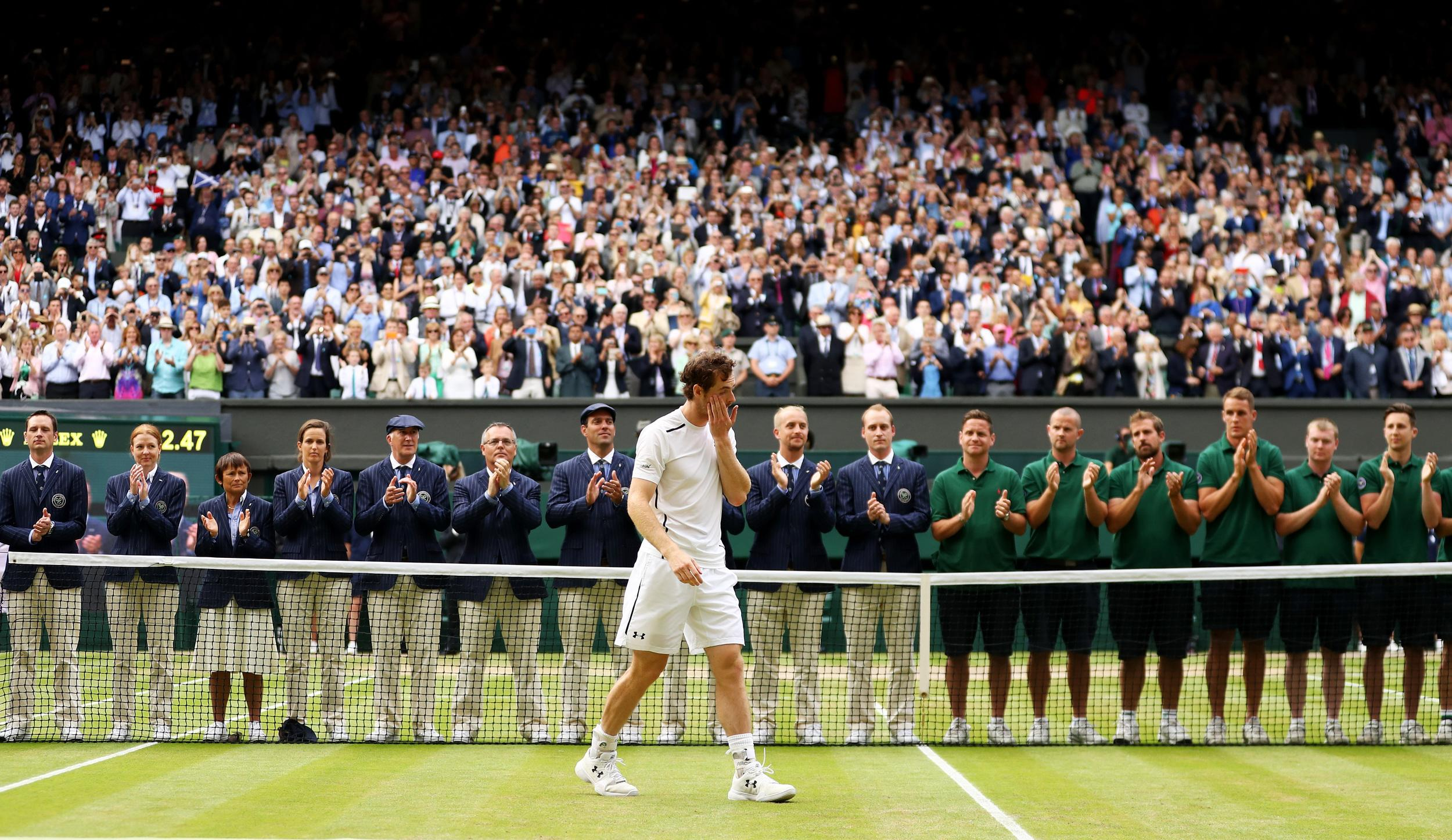 Andy Murray goes to collect trophy.