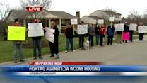 Residents protest housing plan outside official's home