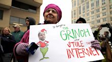 Protesters rally at FCC against repeal of net neutrality rules
