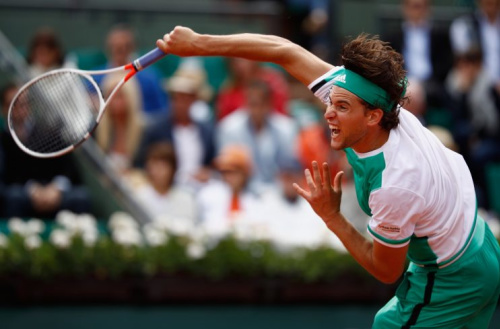 Austria's Dominic Thiem smashes a shot against No. 2 Novak Djokovic in the quarterfinals of the men's French Open. (Getty Images)