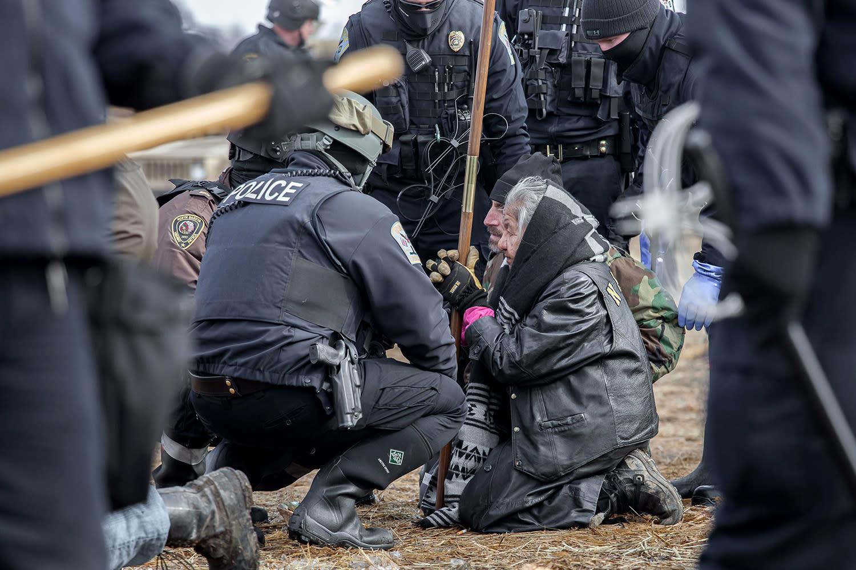 <p>National Guard and Police make arrests at the Octei Sakowin Encampment near Cannon Ball, N.D., Feb. 23, 2017. (Mcknight/Rex Shutterstock via ZUMA Press) </p>
