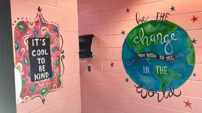 Woman paints motivational messages in middle school bathrooms