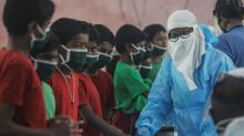Coronavirus surges in Asia bring warnings over complacency