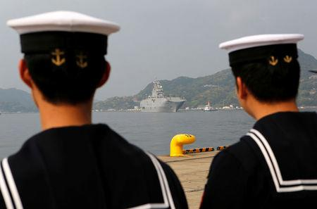French amphibious assault ship Mistral (C) arrives at Japan Maritime Self-Defense Force (JMSDF)'s Sasebo naval base as JMSDF servicemen look on, in Sasebo, Nagasaki prefecture, Japan April 29, 2017, ahead of joint exercises with U.S., British and Japanese forces in waters off Guam. REUTERS/Nobuhiro Kubo
