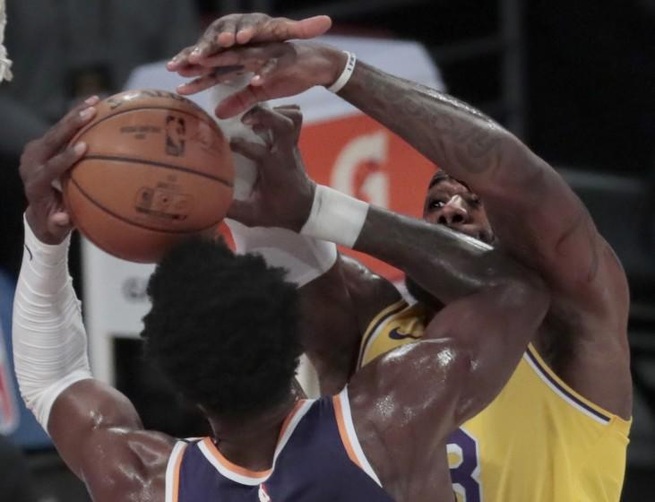 Los Angeles, CA, Tuesday, March 2, 2021 - Los Angeles Lakers forward LeBron James (23) blocks the shot of Phoenix Suns center Deandre Ayton (22) during first half action at Staples Center. (Robert Gauthier/Los Angeles Times)