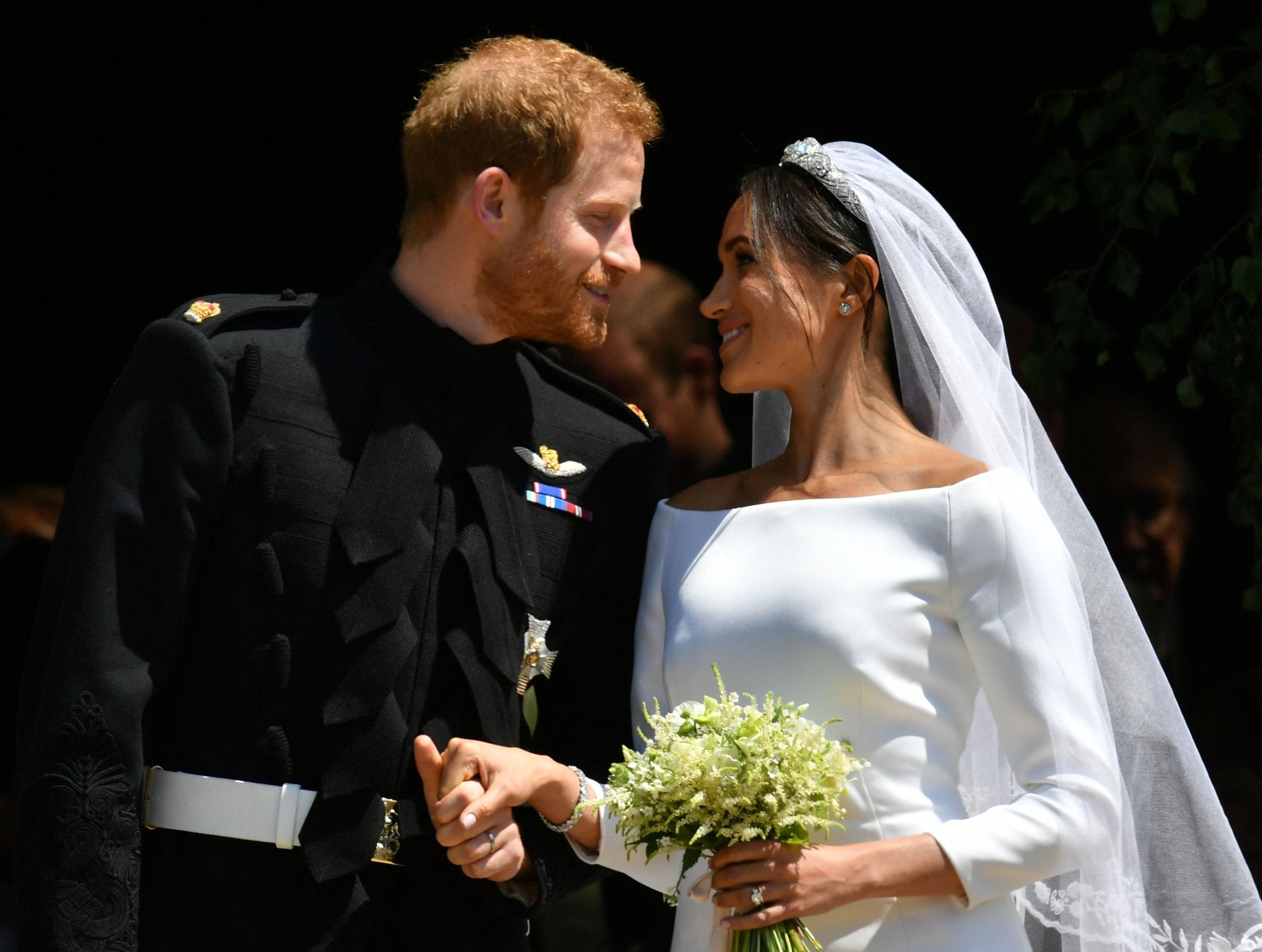 <p>Britain's Prince Harry, Duke of Sussex and his wife Meghan, Duchess of Sussex emerge from the West Door of St George's Chapel, Windsor Castle, in Windsor, on May 19, 2018 after their wedding ceremony.</p>  <p>(Photo by Ben Birchall / POOL / AFP)</p>