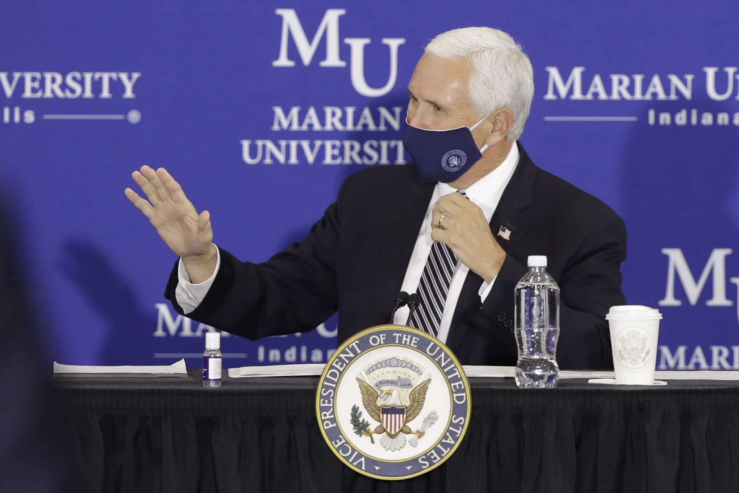 Vice President Mike Pence waves before speaking during a meeting with higher education leaders on safely reopening schools, Friday, July 24, 2020, in Indianapolis. (AP Photo/Darron Cummings)