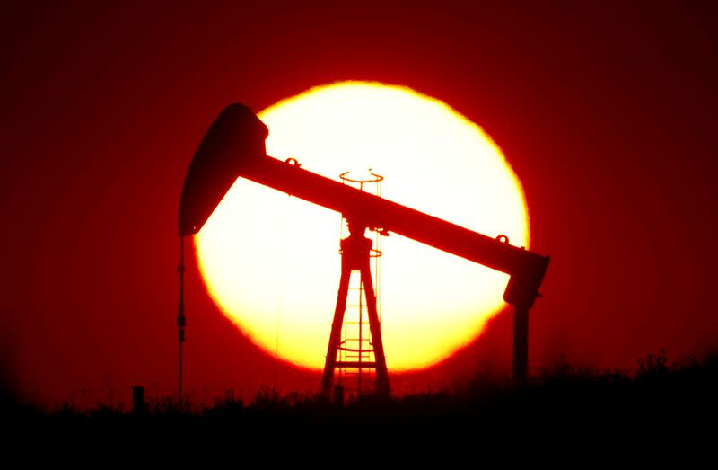 rFILE PHOTO: The sun sets behind a pump-jack outside Saint-Fiacre