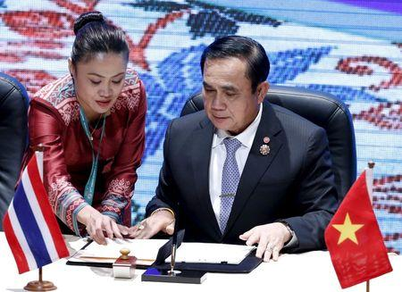 Thailand's PM Prayuth attends a Signing Ceremony Against Trafficking in Persons at the 27th ASEAN summit in Kuala Lumpur