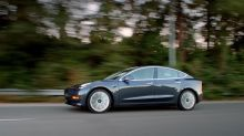 The buzz in Detroit: Who will buy Tesla?