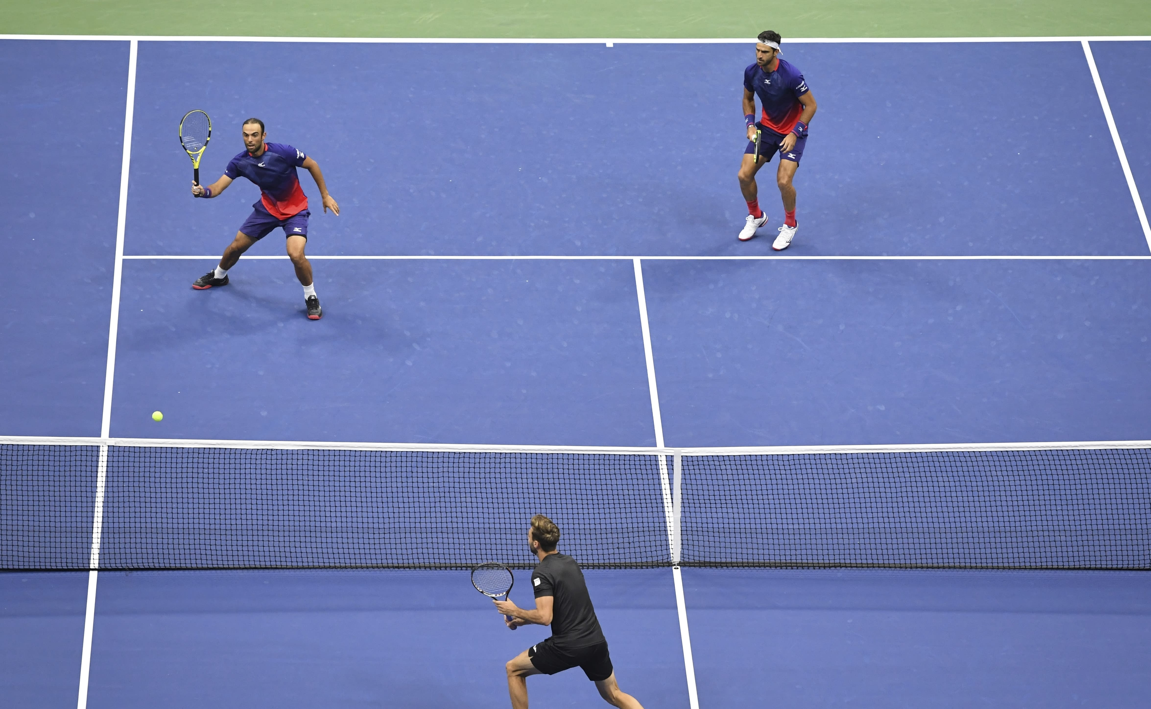 Juan Sebastian Cabal, top left, of Colombia returns a shot to Horacio Zeballos and Marcel Granollers, of Spain, as doubles partner Robert Farah, of Colombia, looks on during the doubles final of the U.S. Open tennis championships Friday, Sept. 6, 2019, in New York. (AP Photo/Sarah Stier)