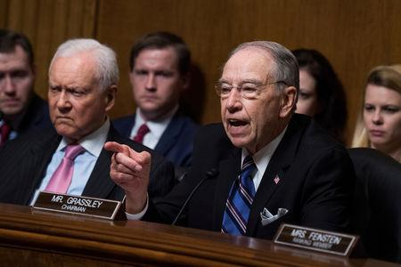 FILE PHOTO: Chairman Charles Grassley, R-Iowa, makes remarks during the testimony of Dr. Christine Blasey Ford during the Senate Judiciary Committee hearing on the nomination of Brett M. Kavanaugh to be an associate justice of the Supreme Court of the United States, focusing on allegations of sexual assault by Kavanaugh against Christine Blasey Ford in the early 1980s. Sen. Orrin Hatch, R-Utah, also appears, in Washington, DC, U.S., September 27, 2018. Tom Williams/Pool via REUTERS/File Photo