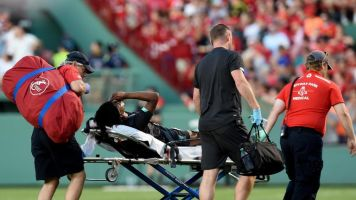 Liverpool youngster Yasser Larouci carried off on stretcher following 'odious' tackle in defeat against Sevilla