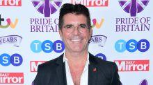 Simon Cowell in hospital after breaking back in bike fall