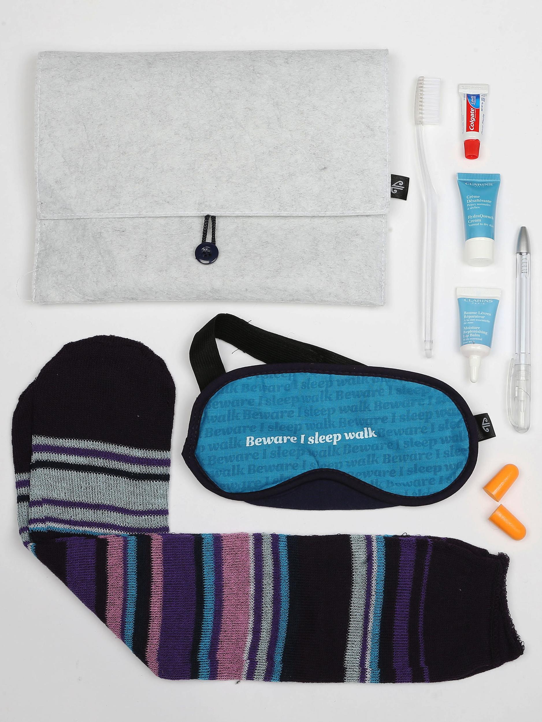 """<p><strong>What do you get?</strong> Socks in Air NZ cabin crew colours, toothbrush, toothpaste, novelty """"Beware I Sleep Walk"""" eye mask, Air NZ pen, ear plugs, Clarins HydraQuench Cream and Moisture Replenish Lip Balm.<br /> <strong>Best bit of the kit?</strong> The novelty eye mask. Air NZ has fun with flying (check out their safety videos and their willingness to rebrand for Hollywood movies). A good unisex product.</p>"""