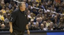 Bob Huggins says he fell to his knees because his defibrillator activated