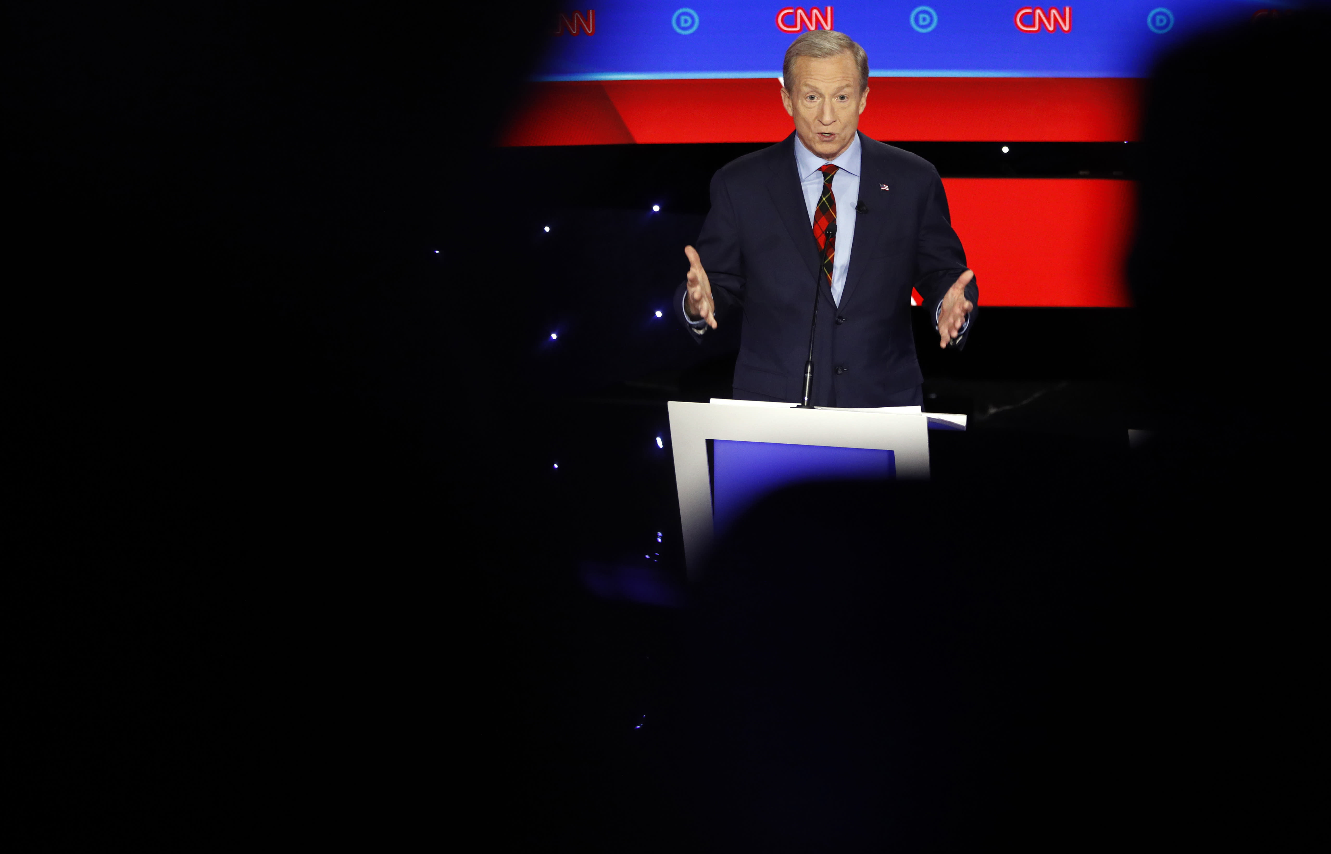 """FILE - In this Tuesday, Jan. 14, 2020 file photo, Democratic presidential candidate businessman Tom Steyer speaks during a Democratic presidential primary debate hosted by CNN and the Des Moines Register in Des Moines, Iowa. On Friday, Jan. 17, 2020, The Associated Press reported on a manipulated video circulating online incorrectly portraying Steyer criticizing Democrats during the Iowa presidential debate saying they would """"destroy the economy in 15 minutes if they get in control."""" The footage was edited to make it appear Steyer made a derogatory comment about Democrats and the economy. (AP Photo/Patrick Semansky)"""