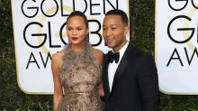 Chrissy Teigen peed on by son