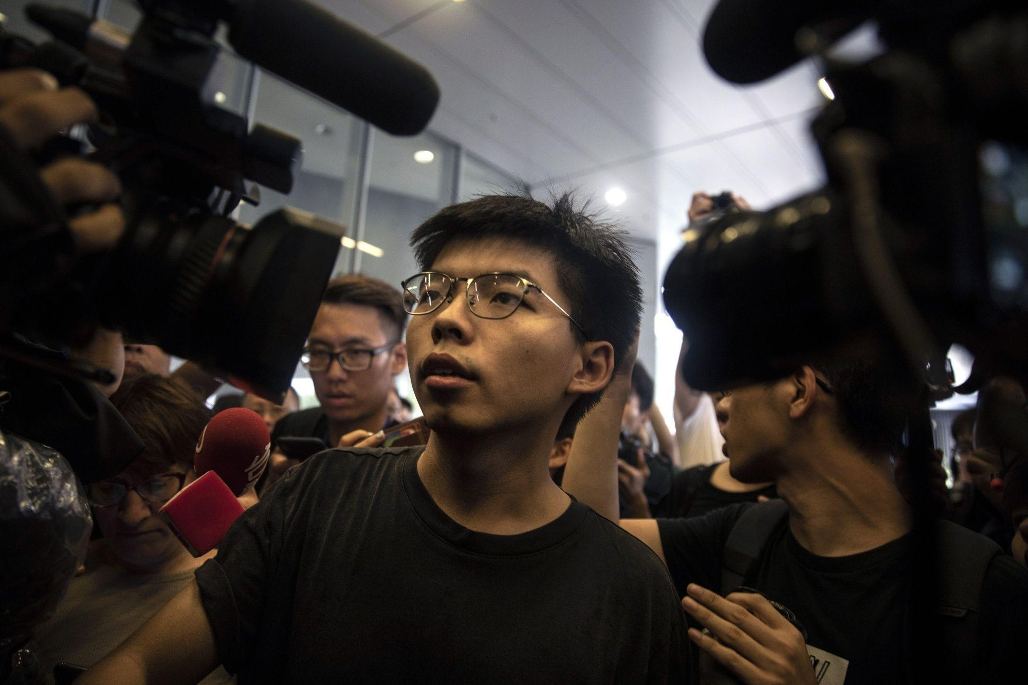 Hong Kong democracy activist Joshua Wong arrested ahead of weekend protests