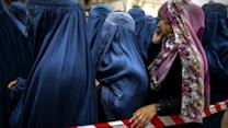 Afghanistan runs out of ballot papers as election turnout surprises