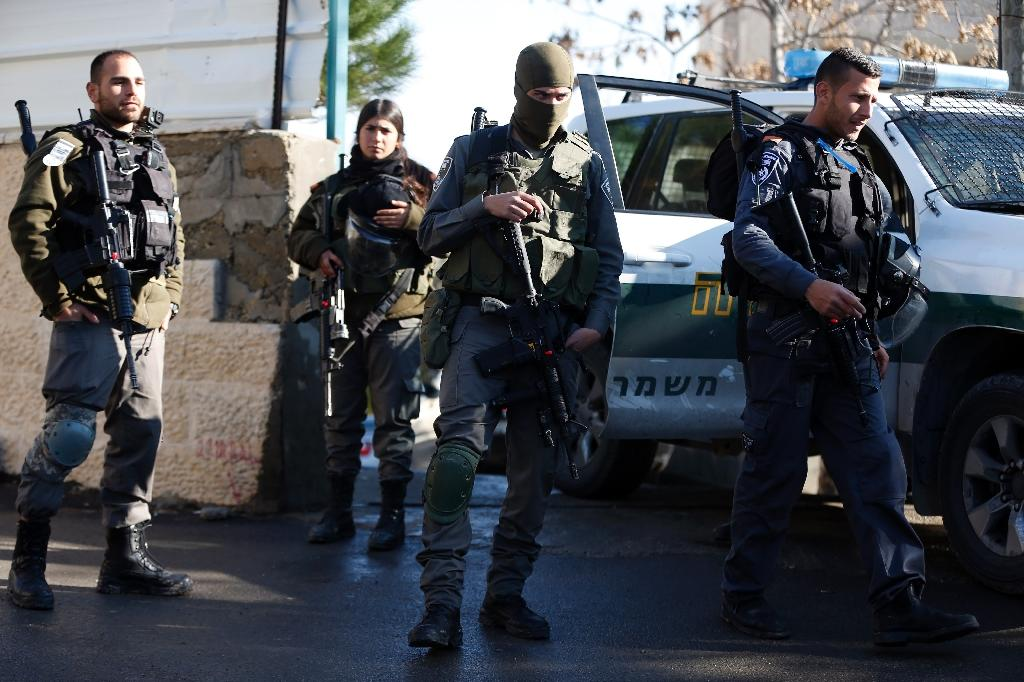 Israeli soldiers stand guard outside the house of Alaa Abu Jamal, who was shot dead after reportedly running over and stabbing a rabbi at a Jerusalem bus stop in October 2015, in the east Jerusalem neighbourhood of Jabal Mukaber on January 4, 2016