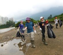 Eleven-year-old climate activist leads beach cleanup in Hong Kong