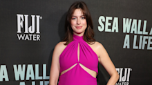 Pregnant Anne Hathaway takes maternity dressing to new levels in hot pink cut-out dress
