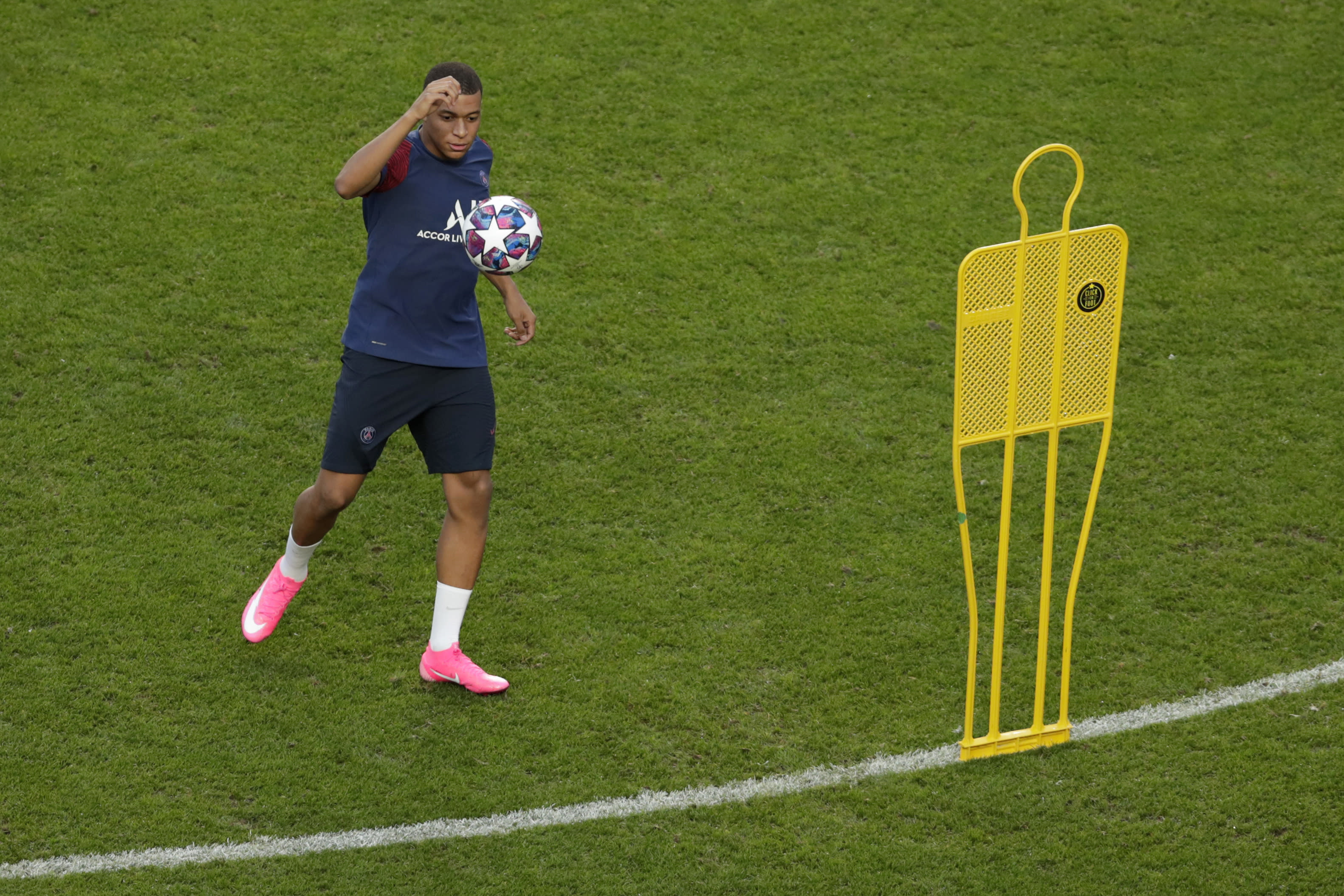 PSG's Kylian Mbappe plays with a ball during a training session at the Luz stadium in Lisbon, Saturday Aug. 22, 2020. PSG will play Bayern Munich in the Champions League final soccer match on Sunday. AP Photo/Manu Fernandez, Pool)